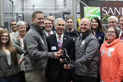 Sandridge Foods Ribbon Cutting inside of plant group photo