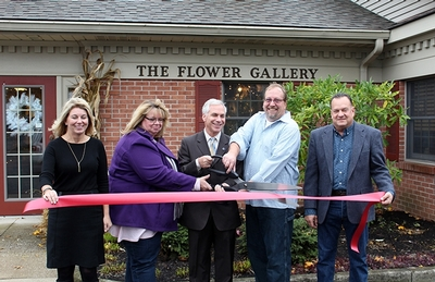 Flower Gallery ribbon cutting ceremony outside of store